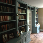 bespoke fitted cabinets with bookcase uppers