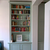 built in alcove base cabinet with bookcase above