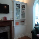 built in alcove cabinet with display shelves