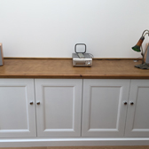 custom fitted cupboards finished with an oak decor top