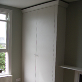 bespoke fitted wardrobe finshed in farrow & ball strong white