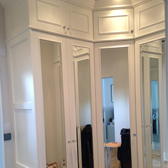 custom fitted wardrobes with mirrored doors and top storage boxes