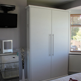 fitted wardrobe with decor end panel