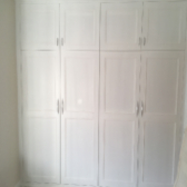fitted wardrobe with top storage